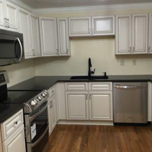 Custom Kitchen Renovation with Flooring Installation by Ubaldo Construction